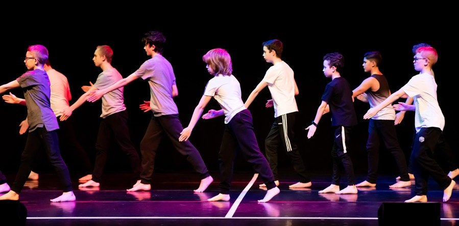 Rubicons flagship boys group, Re:BOUND, performing at the Schools Dance Festival, St Davids Hall.