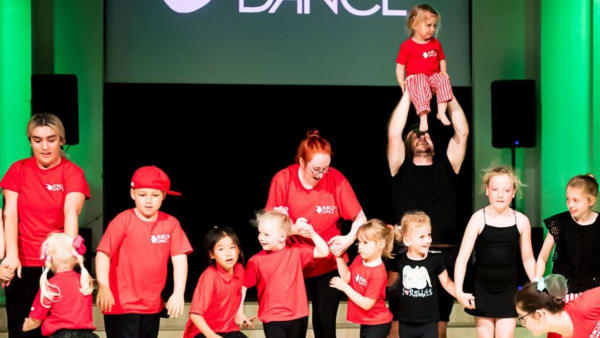 Rubicons creative dance group performing in red t-shirts.