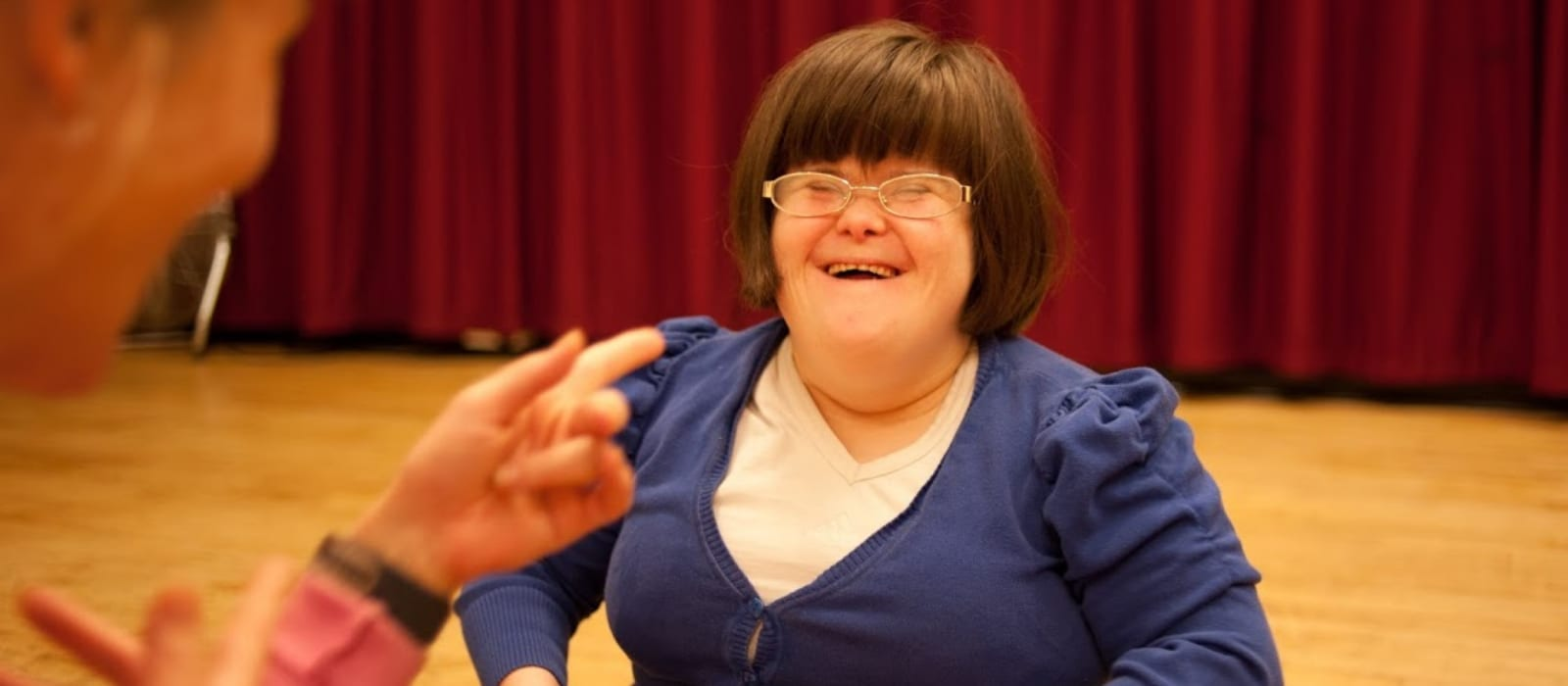 A dancer smiling in Rubicons dance for disabled adults session.