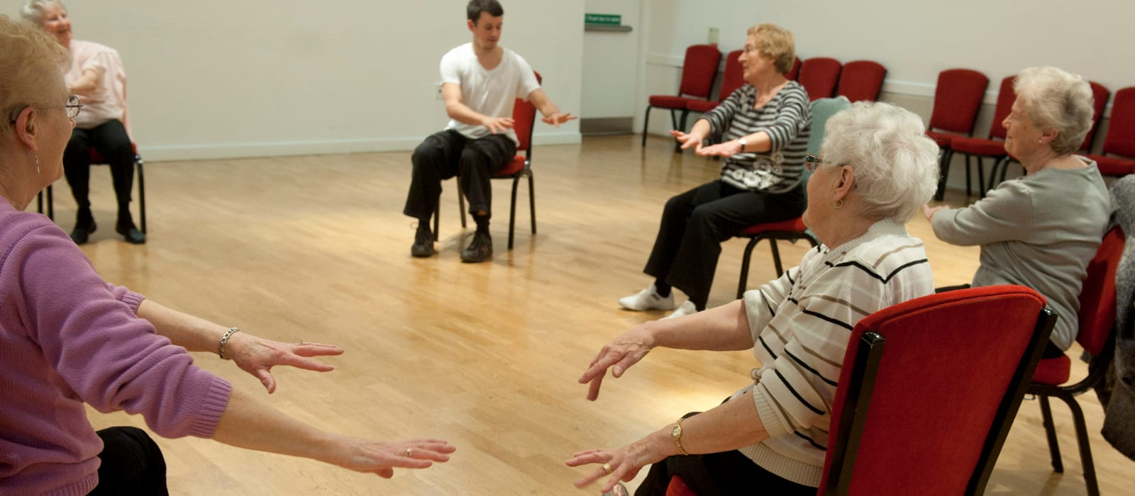 Stow Park over 60s group taking part in a seated session.