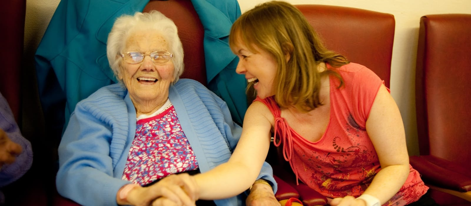 Rubicon dance leader with a participant during a seated session in a care home.