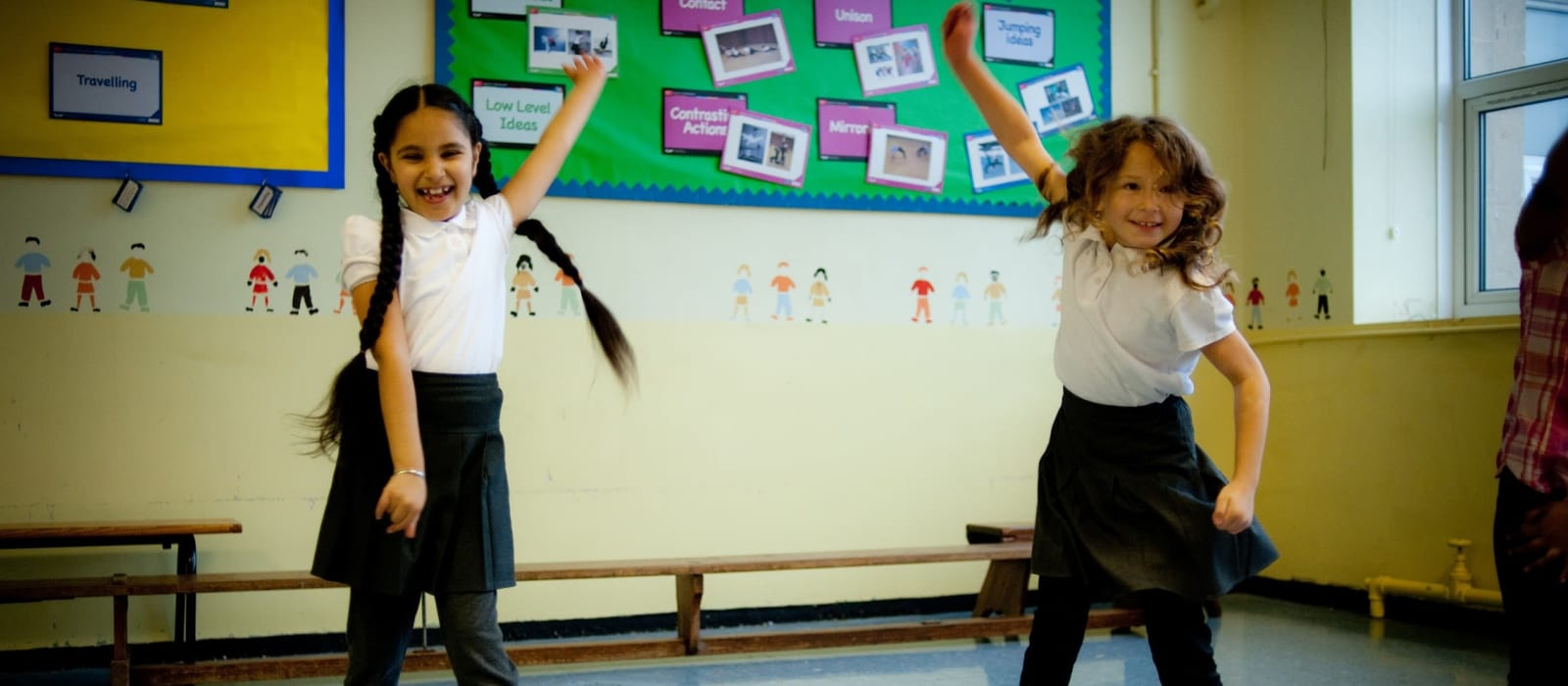 A Rubicon session in a school. Two dancers jumping.